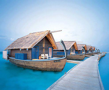 Boat Hotel - Cocoa Island by COMO, South Male Atoll, Maldives  Number of Bungalows: 33  What's Unique: Just a 40-minute speedboat ride from the Maldives' international airport, this luxurious COMO resort on the private Cocoa Island (known locally as Makunufushi) is like no other. Cocoa Island by COMO's overwater-bungalow suites are built in the style of traditional Dhoni, the wooden boats used by local fishermen. They might look like mini Noah's arks, but these suites don't actually float. They're fixed to stilts over the Indian Ocean and include private sundecks, luxurious bathrooms, and large windows with gorgeous views.  Over-the-Top Services: Wellness is a major focus at the resort, with therapies at the Shambhala Retreat center and Shambhala raw-cuisine options. Take a yoga or meditation class in the retreat center's open-air pavilion, or experience India's holistic Ayurvedic therapy in one of four massage-treatment rooms. Cocoa Island butlers often arrange intimate dinners for guests and give guided snorkeling tours.  Rates: From $800 per night