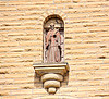 Above the rose window and front doors stands a stone statue of St. Fidelis. St. Fidelis church and cemetery, Victoria, KS