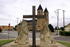 Volga-German imigrant statue and St. Fidelis Church