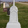 A white bronze (zinc) cross and marker. KS St. Fidelis Cemetery, Victoria, KS