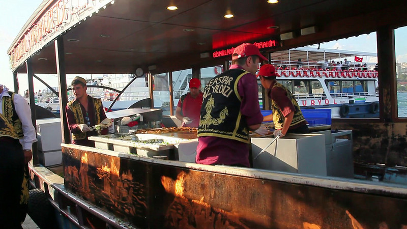 Eminonu (european side of Istanbul). Fish and Bread. These guys are working like crazy all day long, for peanuts... (duration: 00:18)