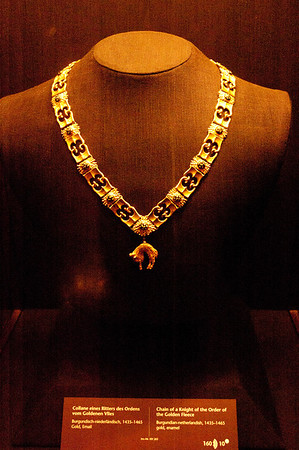 This is a chain from a knight in the Order of the Golden Fleece.  When the the Burgundian lands were absorbed into the Habsburg empire, they inherited the Order of the Golden Fleece.  This is a piece dating back from the early 15th century.  The Order of the Golden Fleece still exists to this day.