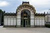 This is a train station entrance designed by Otto Wagner.  He designed many other buildings for Vienna, though few of them were actually built.