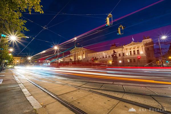 Traffic around the Parliament at night