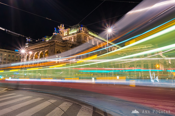 A tram whizzing past the Vienna Opera House