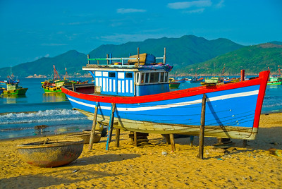 Beached fishing boats and the fleet offshore - Quy Nhon - Vietnam