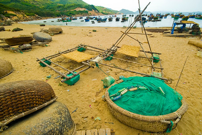 A fishing village beach covered with the tools of the trade - Quy Nhon - Vietnam