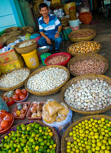 Streetside vendor with baskets of fresh local produce - Qui Nhon - Veitnam