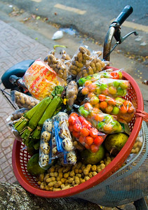 Street vendors bicycle loaded with local foods - Ho Chi Minh City (Saigon)