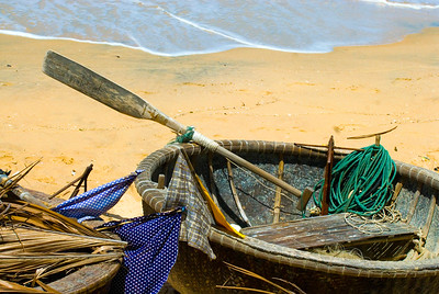 Traditional Vietnamese basket boat (thung chai) await the incoming tide.