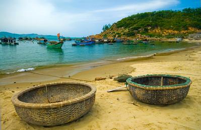 Traditional basket boats (thung chai) ashore and the fishing fleet at anchor - Quy Nhon - Vietnam