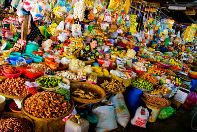 A wide aray of colorful goods on display at street market - Vietnam
