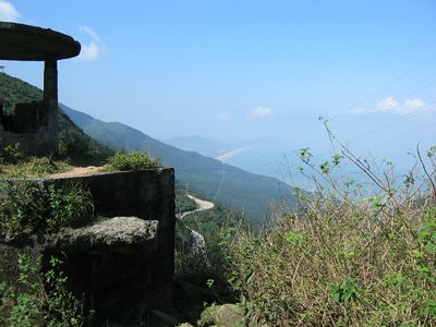 """The Hai Van Pass (""""Pass of the Ocean Clouds"""") is on the serpent road from Hue to Da Nang. This spectacular mountain pass was an American stronghold in the Civil War and saw much damage from shelling and guns."""