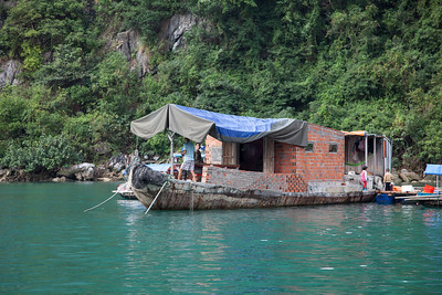 A boat in the fishing village made of concrete and bricks.