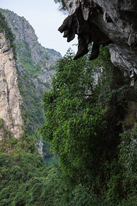 Rocks hanging down like a man's feet, near the exit of Amazing Cave.