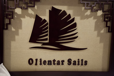 "An unfortunate spelling error in the wooden headboard of my cabin in the boat. It is supposed to read ""Oriental Sails."""