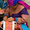 Hmong Woman Needlepointing at the Market in Sapa, Vietnam
