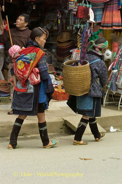 Hmong Hill Tribe Woman and Baby Leaving Market in Sapa Vietnam