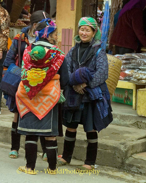 Hmong Women and Sleeping baby Outside of Market in Sapa Vietnam