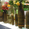Saigon morbid sense of humor-- flower pots of US military shells.