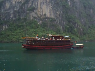 Vietnamese houseboats, modeled after ancient Chinese junks, ply the waters of Ha Long Bay and are an important source of tourist revenue.