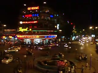 Very chaotic and busy round-about beside the lake in central Hanoi.
