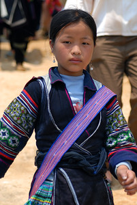 Young Hmong girl in traditional attire.