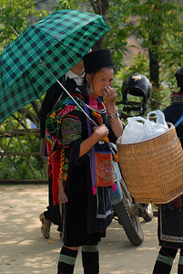 © Joseph Dougherty. All rights reserved.   Black H'mong women headed to the market at Sa Pa Town, half way up the Muong Hoa Valley.