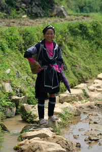 © Joseph Dougherty. All rights reserved.   Hmong woman walking along the rice paddy fields in Vietnam.