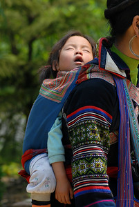 © Joseph Dougherty. All rights reserved.   Child asleep on her mother's back.