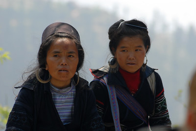 """© Joseph Dougherty. All rights reserved.   Two H'mong women watch and make fun as the silly foreigners """"hike"""" the valley.   Stooopid tourists..."""