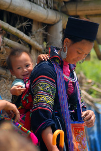 Young Black Hmong woman with her child.
