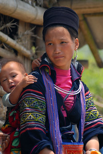 © Joseph Dougherty. All rights reserved.   Young Black Hmong woman with her child.