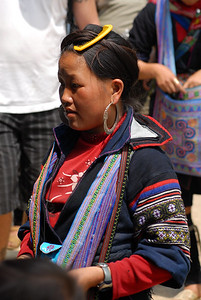© Joseph Dougherty. All rights reserved.   H'mong girl selling textiles