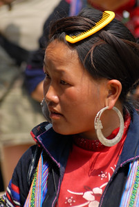 © Joseph Dougherty. All rights reserved.   H'mong girl showing the traditional, large hooped silver earrings common in the hill tribes.