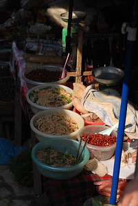 Salads, beans, and raw pork for sale in the central market of Sa Pa.