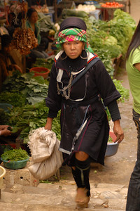 A woman from the Zai hilltribe hurries through the market.