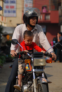 Motorbikes are the most efficient and common form of personal transportation, second only to feet. Riding bicycles is too difficult in the hilly terrain of the valley.