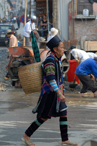 A woman from the Black H'mong hilltribe walks toward the Sa Pa market.