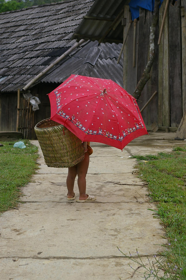 SaPa resident with red umbrella.
