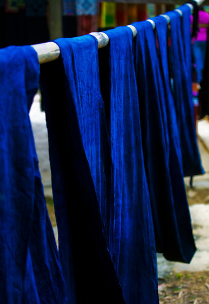 Indigo cloth. The stains on the hands of most Black Hmong women come from dying cloth with indigo plant leaves. The process takes one month of pushing down the cloth into the indigo dye vats.