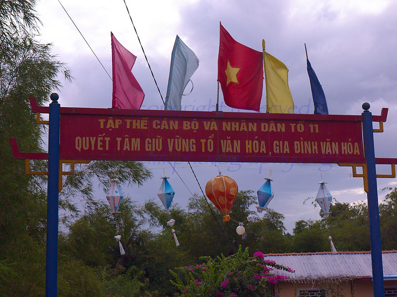 Vietnam Banners and lanterns across the road<br /> <br /> Not to be reproduced in any form without written permission from emkphotography.org