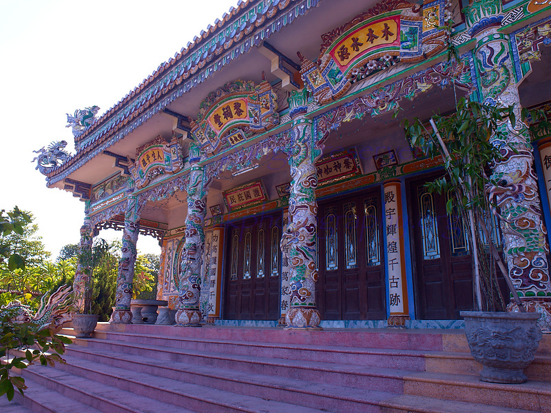 Vietnam Tomb entrance to inner courtyard, elaborate  columns embedded with colourful mosaics<br /> Not to be reproduced in any form without written permission from emkphotography.org