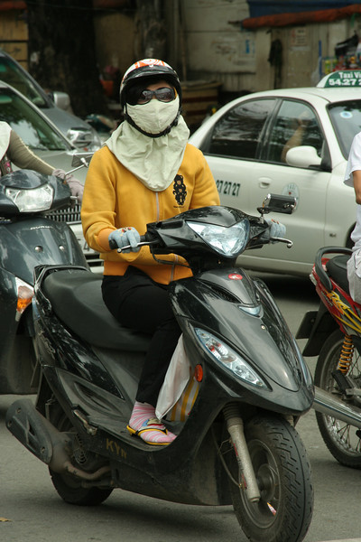 Street scene, Vietnam.  Masks to protect against pollution.