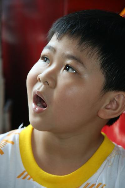 Watching the incense rise at a pagoda.  Saigon, Vietnam