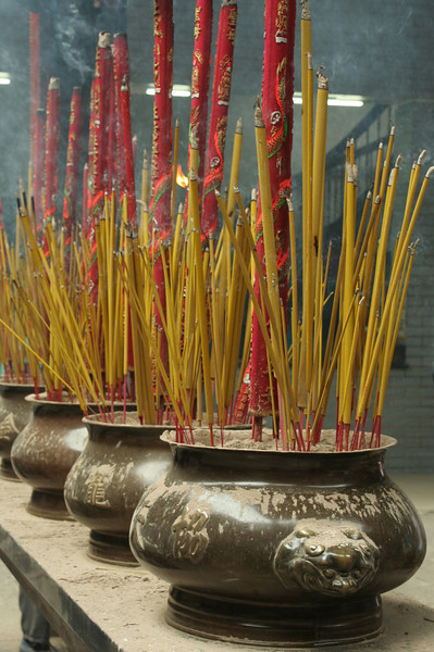 Offerings at a pagoda in Chinatown, Saigon, Vietnam