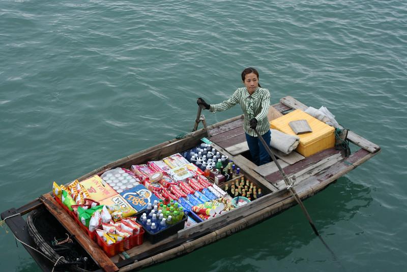 Floating merchant.  Ha Long Bay, Vietnam