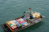 Floating merchant.  Ha Long Bay, Vietnam