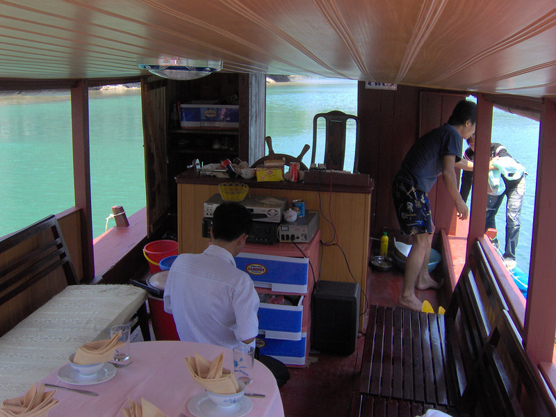 The captain/owner of the boat cooked us an entire four course meal on a wok in that little closet in the back left corner.
