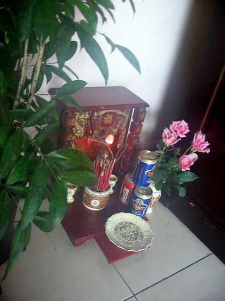 Every business and home has a small shrine to the ancestors where small offerings are made.